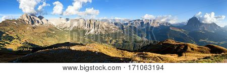 Evening panoramic view of Geislergruppe or Gruppo delle Odle and Sella gruppe or Gruppo di Sella Alps Dolomites mountains Dolomiti Italy