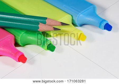 Set of felt pens and pencils on white background