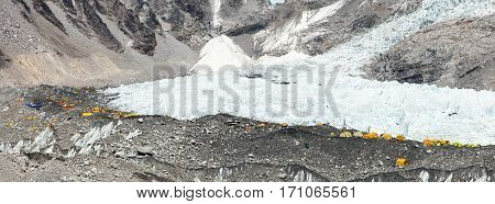 View from Mount Everest base camp yellow tents and prayer flags trek to Everest base camp - Nepal