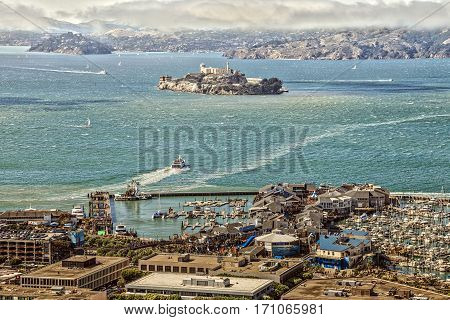 San Francisco California United States - August 14 2016: Aerial view of Port of San Francisco Alcatraz Island and Fisherman's Wharf from top of Coit Tower.
