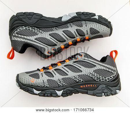 New York February 3 2017: A pair of brand new gray men's Moab Edge trail shoes by Merrell isolated on white background.
