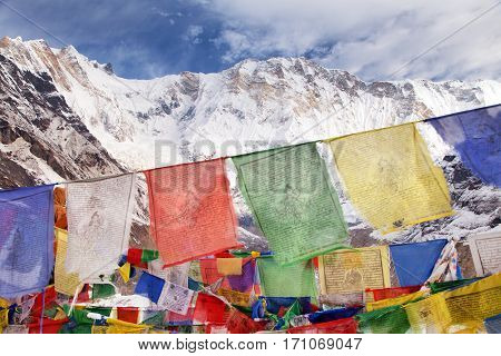 Buddhist prayer flags and Mount Annapurna from Annapurna base camp Nepal