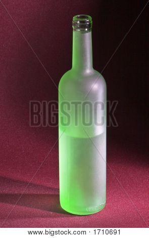 ..Near-Empty Matt Green Glass Bottle
