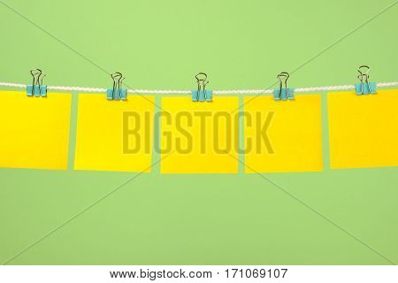 Empty Yellow Paper Notes Hanging On The String