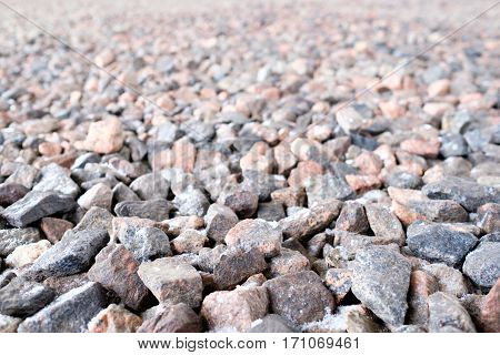 Crushed stone abstract textured background. Close focus