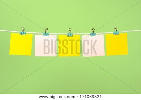 Blank Yellow And Pink Paper Notes On The String