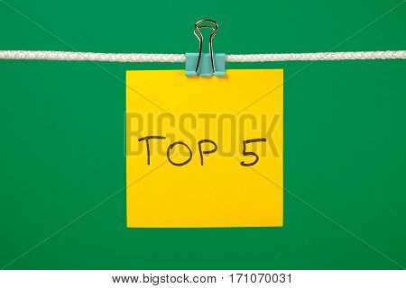 """Yellow Paper Note On Clothesline With Text """"top 5"""""""
