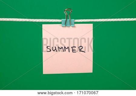 """Pink Paper Note On Clothesline With Text """"summer"""""""