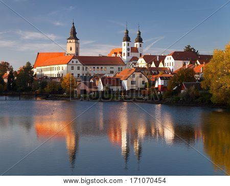 Evening view of Telc or Teltsch town mirroring in lake World heritage site by unesco in Czech Republic