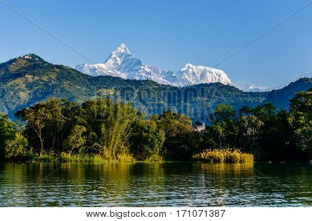 The Machapuchare (left, 6993m) and Annapurna III (right, 7555m) seen from Phewa Lake in Pokhara, Nepal