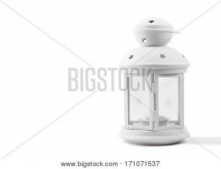 Christmas decorative white lantern on a light background.
