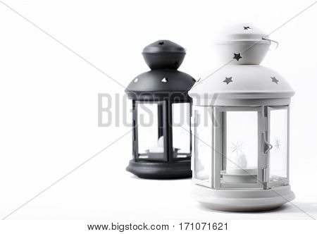 Christmas decorative black and white lanterns on a light background.