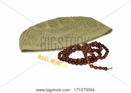 Pictures of Islami seccade, tesbih, misvak and takke