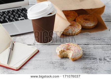 Office Workplace With Breakfast. Donuts And Coffee