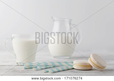 Kid Breakfast With Milk And White Macaroons On Table