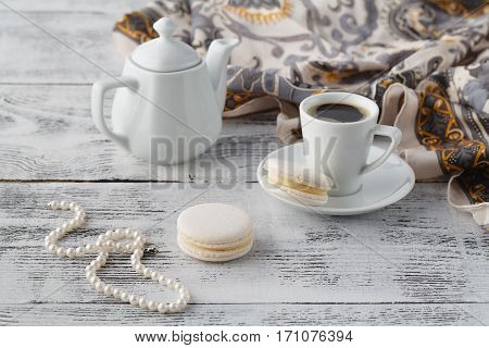 Woman Breakfast With Shawl And White Macaroons