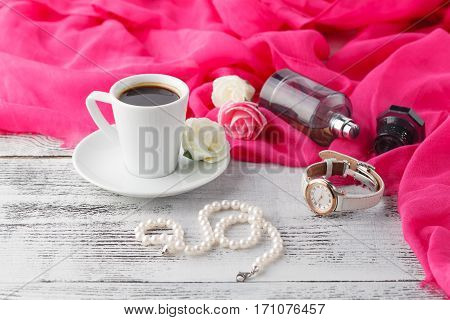 Woman Relax Coffee Time With Shawl And Parfum Bottle On Table