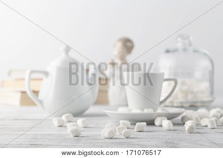 Coffee In White Porcelain Cup On Wooden Table