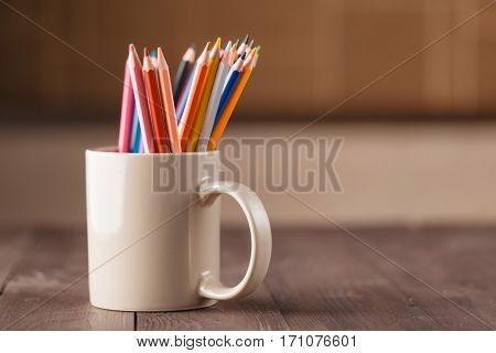 Many Pencils In Mug On Wooden Table