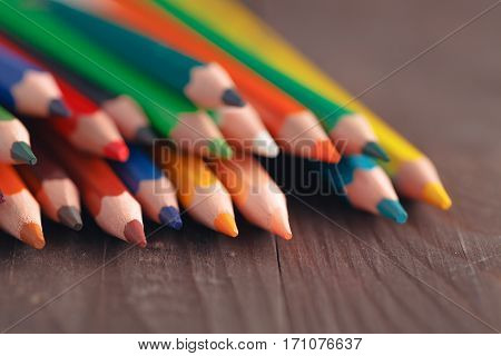 Row Of Colour Pencils On Wooden Table