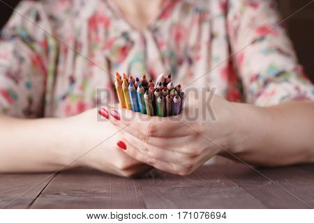 Bunch Of Colored Pencil In Woman Hands