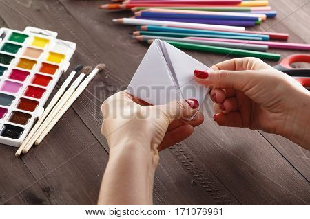 Adult Woman Do Origami Boat