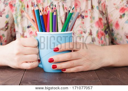 Woman Hold Mug With Many Color Pencil