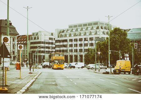 BERLIN, GERMANY - JUNE 21: Infrastructure with road traffic bus stops and business buildings at Stralauer Street on June 21, 2016 in Berlin.