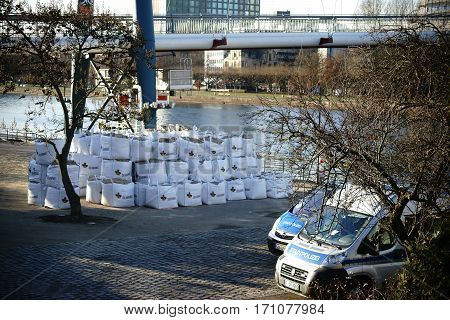 FRANKFURT, GERMANY - JANUARY 05: Police patrol cars and bags of debris are on the banks of the Main to salvage a bomb from World War 2 on January 05, 2017 in Frankfurt.