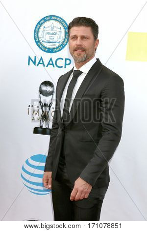 LOS ANGELES - FEB 11:  Greg Vaughn at the 48th NAACP Image Awards Arrivals at Pasadena Conference Center on February 11, 2017 in Pasadena, CA