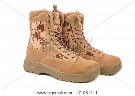 Desert brown canvas combat boots, isolated on the white