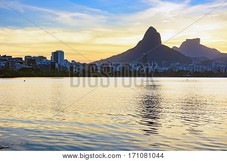 Image of the late afternoon at Lagoa Rodrigo de Freitas in Rio de Janeiro with its mountains buildings and characteristic outline