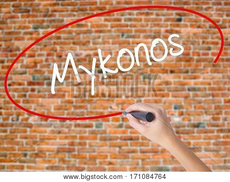 Woman Hand Writing Mykonos With Black Marker On Visual Screen