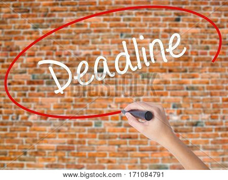 Woman Hand Writing Deadline With Black Marker On Visual Screen