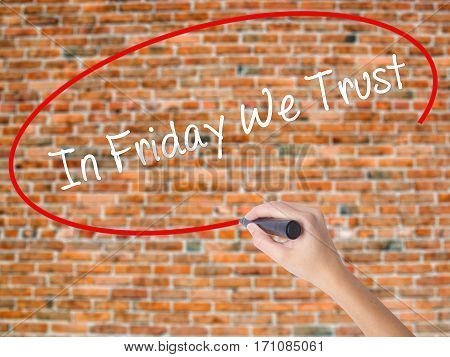 Woman Hand Writing In Friday We Trust  With Black Marker On Visual Screen