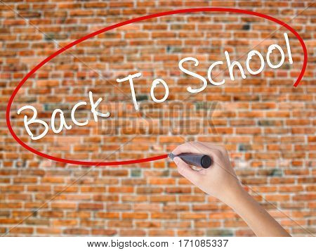Woman Hand Writing Back To School With Black Marker On Visual Screen