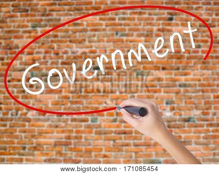 Woman Hand Writing Government With Black Marker On Visual Screen
