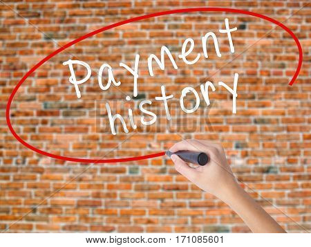 Woman Hand Writing Payment History With Black Marker On Visual Screen