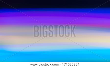 horizontal streaks of light in shades of turquoise, white and violet