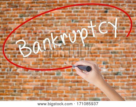 Woman Hand Writing Bankruptcy With Black Marker On Visual Screen