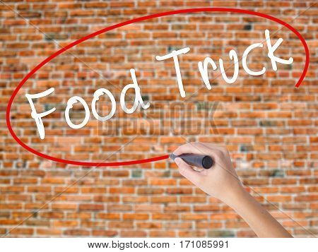 Woman Hand Writing Food Truck With Black Marker On Visual Screen