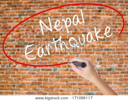Woman Hand Writing Nepal Earthquake With Black Marker On Visual Screen