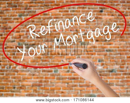 Woman Hand Writing Refinance Your Mortgage With Black Marker On Visual Screen