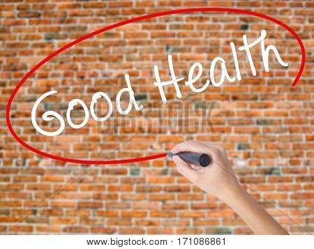 Woman Hand Writing Good Health With Black Marker On Visual Screen