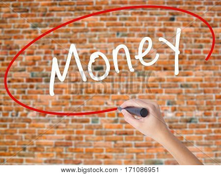 Woman Hand Writing Money With Black Marker On Visual Screen