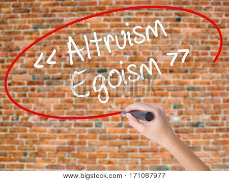 Woman Hand Writing Altruism - Egoism With Black Marker On Visual Screen.