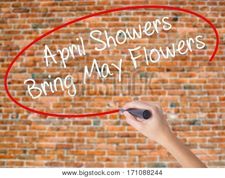 Woman Hand Writing April Showers Bring May Flowers With Black Marker On Visual Screen