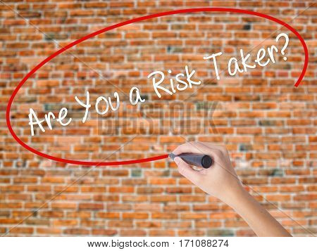 Woman Hand Writing Are You A Risk Taker? With Black Marker On Visual Screen