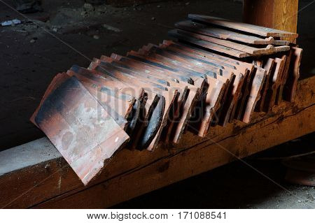 old roof tiles spare building material in the attic