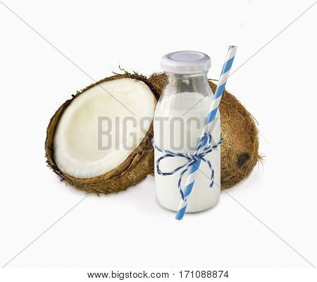 milk of coconut and fresh coconuts isolated on white background. Сoconut with copy space for text.